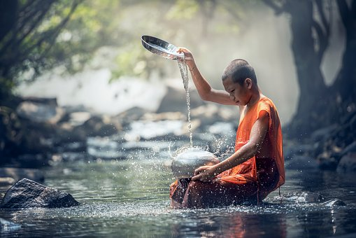pouring water on stone